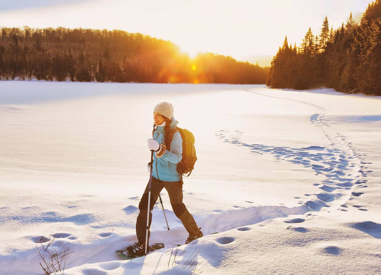 Woman Snowshoeing at Sunset